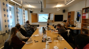 The workshop participants are listening carefully.
